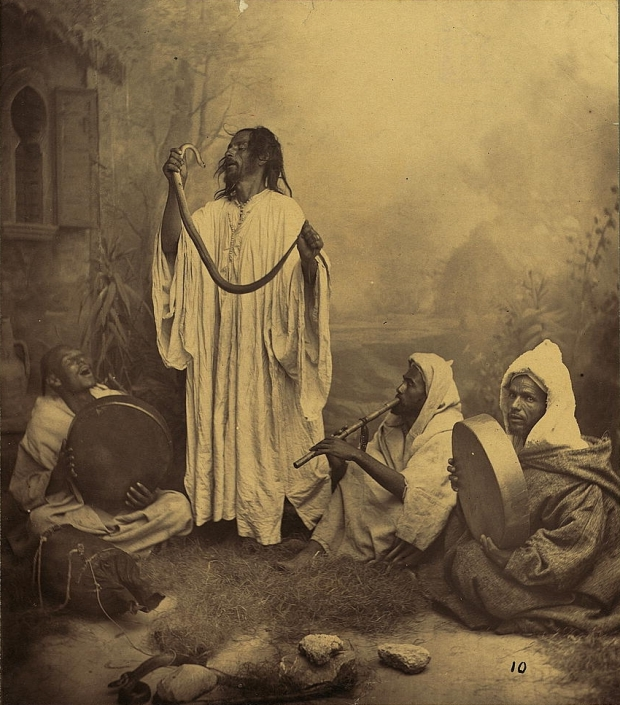 Snake charmer in Morocco, mid- to late- 1800s. By Tancrède Dumas (1830-1905) [Public domain], via Wikimedia Commons
